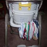 Store bibs on the back of the high chair