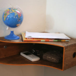 Turn a wooden magazine holder into a corner shelf or charging station