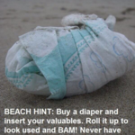 "Keep valuables hidden while at the beach by storing them in a rolled-up diaper ""safe"""