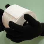 "Old gloves transform into a creepy toilet paper ""butler"""