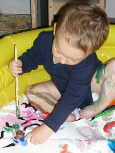 Finger painting in a wading pool