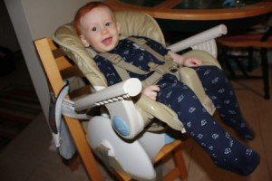 Reclining high chair makes for hands-free snot suctioning or medicine dosage