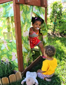 backyard-clubhouse-staple-oilcloth-to-a-play-structure