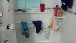 add-a-swimsuit-drip-dry-zone-to-your-shower-with-a-tension-rod