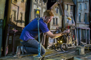 Adjusting props on the set of The Boxtrolls